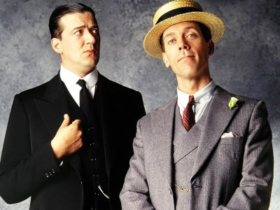 Stephen Fry and Hugh Laurie December 2001 Dressed as Jeeves and Woostersm. Mirrorpix/Courtesy Everett Collection (MPWA3842682_2)